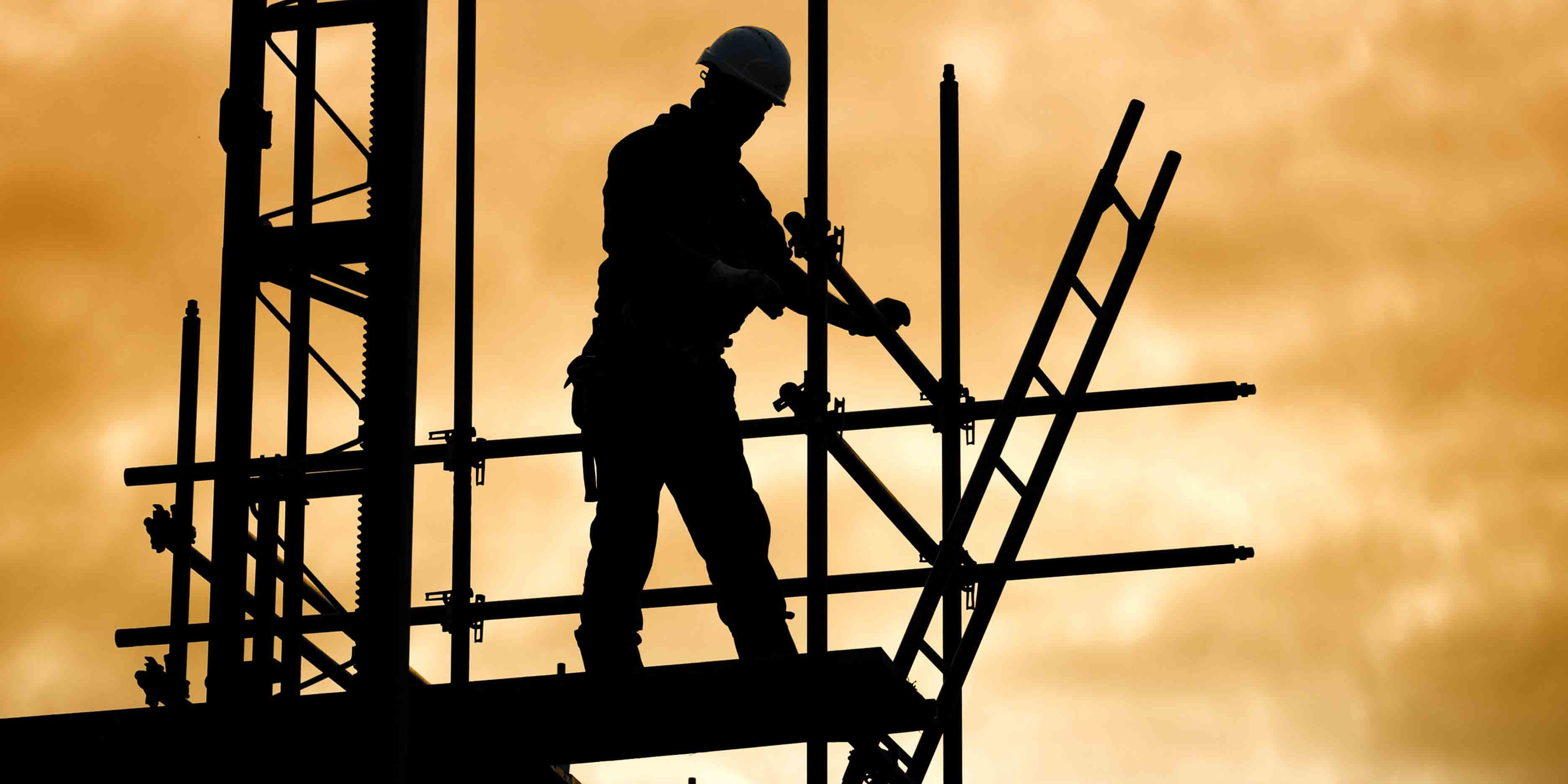 Scaffolder securing poles Thirsk Scaffolding North Yorkshire North East England